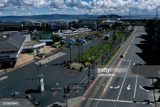 An aerial view from a drone shows streets virtually deserted at the Pier 39 tourist destination on March 26 2020 in San Francisco California With...