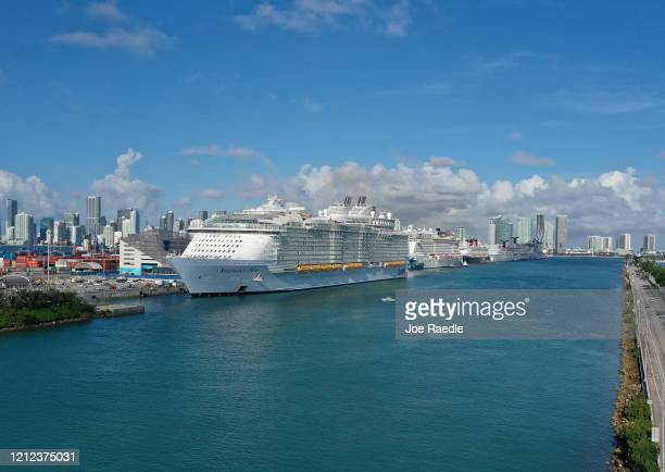 An aerial view from a drone shows the Royal Caribbean Symphony of the Seas Cruise ship which is the world's largest passenger liner docked at...