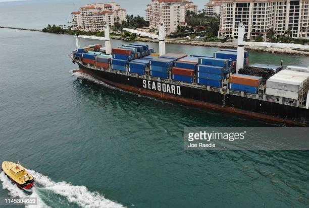 An aerial view from a drone shows the Seaboard Marine cargo ship leaving PortMiami on the day that the Bureau of Economic Analysis announced that the...