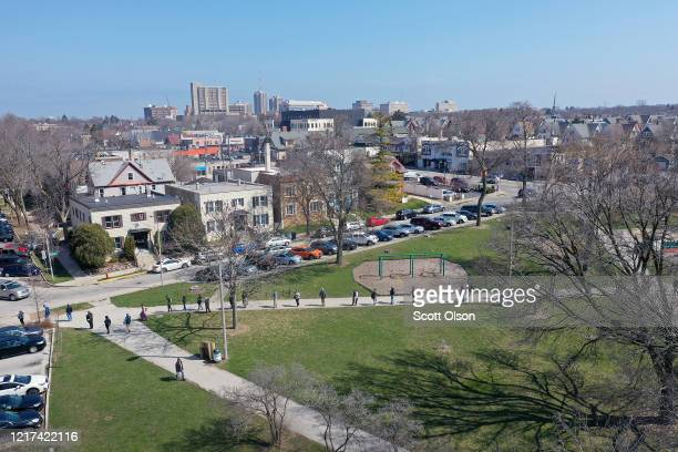 An aerial view from a drone shows voters waiting in line to enter a polling place at Riverside University High School on April 07 2020 in Milwaukee...