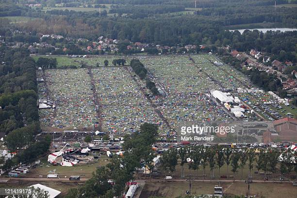An aerial view from a helicopter shows the muddy grounds of the Pukkelpop music festival after yesterday's storm and accident on August 19 2011 in...