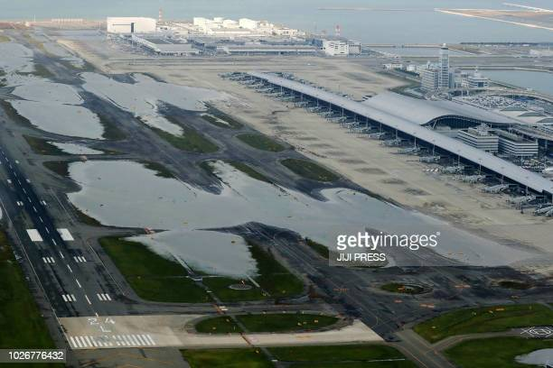 TOPSHOT An aerial view from a Jiji Press helicopter shows flooding at the Kansai International Airport in Izumisano city Osaka prefecture on...