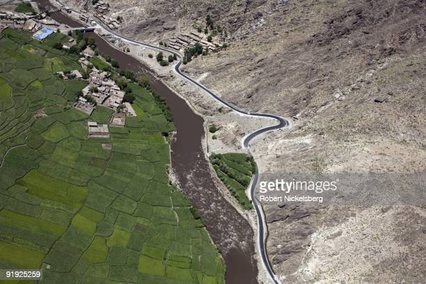 An aerial view from a US Army helicopter shows farm fields of wheat and corn along the Pech River valley September 4 2009 between Asadabad the...