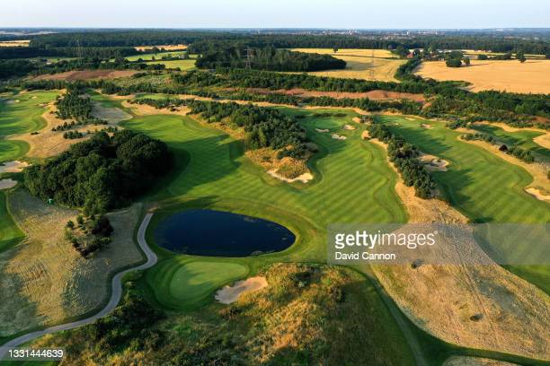 An aerial view from behind the green of the par 4, 12th hole with the par 4, 10th hole to the right and the par 4, 8th hole on the far right of the...