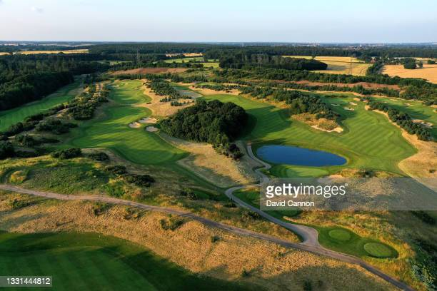An aerial view from behind the green of the par 4, 12th hole with the par 4, 10th hole to the right and the par 5, 13th hole at The Centurion Club on...