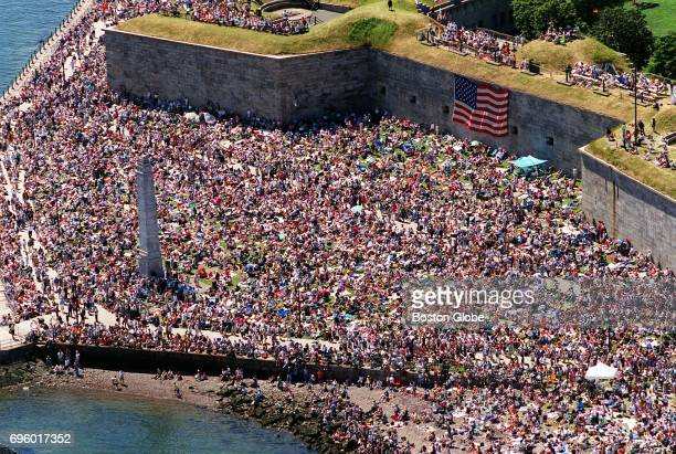 An aerial view from the Hood Airship as it rides above a packed Castle Island in South Boston during Sail Boston on July 11 2000