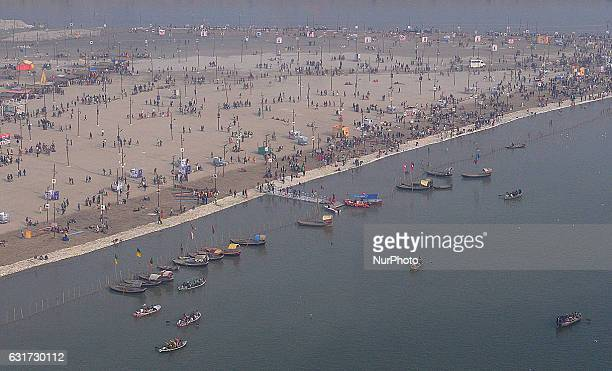 An aerial view is seen as Indian devotees gather on the banks of Holy Sangam to take a holy dip on Makar Sankranti the first Bathing day of Month...