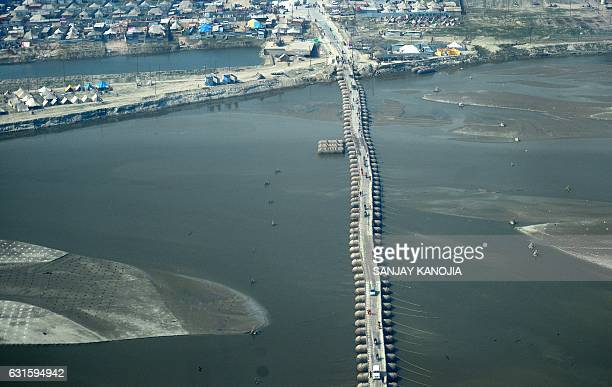An aerial view is seen of a temporary pontoon bridge built over the river Ganga during the Magh Mela festival in Allahabad on January 13 2017 The...