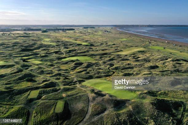 An aerial view looking back to the par 3, third hole in the foreground with the links and Sandwich bay behind at the host venue for the 2021 Open...