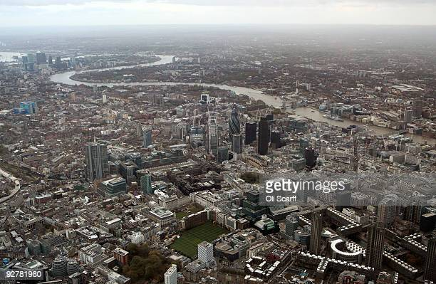 An aerial view looking South East of highrise buildings in the City of London and the river Thames on November 4 2009 in London England The UK's...