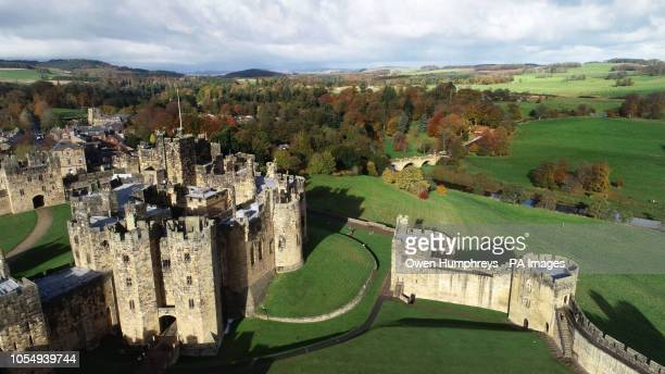 An aerial view of a Alnwick Castle Northumberland surrounded by autumn colours