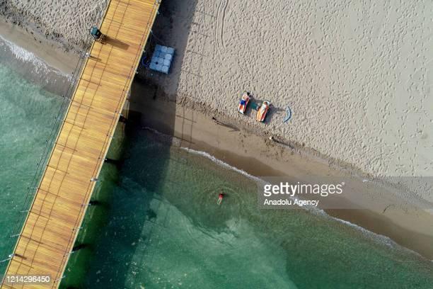 An aerial view of a beach as people sun bathe during spring season amid coronavirus pandemic precautions in Belek district of Antalya Turkey on May...