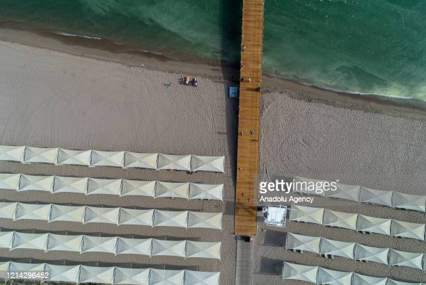 An aerial view of a beach as people sun bathe during spring season amid coronavirus pandemic precautions in Belek district of Antalya, Turkey on May...