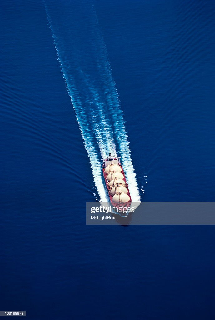 An aerial view of a boat on water for the oil industry : Stock Photo