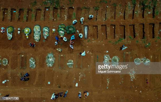 An aerial view of a burial of a Covid-19 victim at the Vila Formosa cemetery during the coronavirus pandemic on January 7, 2021 in Sao Paulo, Brazil....
