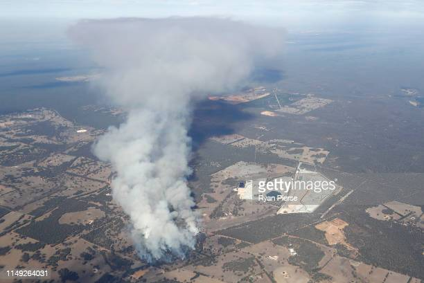 An aerial view of a bushfire which is threatening homes in parts of The Lakes Copley and Woottating in the shires of Northam and Mundaring to the...