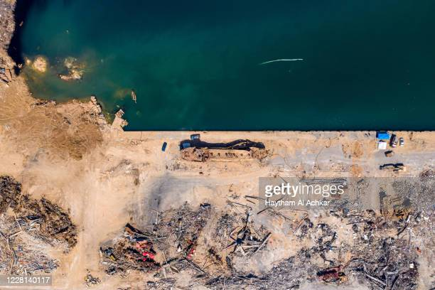 An aerial view of a capsized ship, damaged in the Beirut Port blast, on August 21, 2020 in Beirut, Lebanon. The explosion at Beirut's port killed...