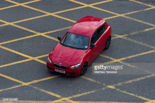 An aerial view of a car in a yellow box junctions on September 21, 2014 in Cardiff, United Kingdom.