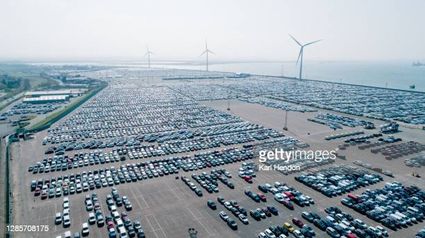 an aerial view of a car plant with wind turbines - industry stock pictures, royalty-free photos & images