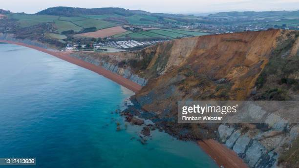An aerial view of a cliff fall on April 14, 2021 in Seatown, United Kingdom. The 4,000-ton rockfall at Seatown has blocked off the beach between...