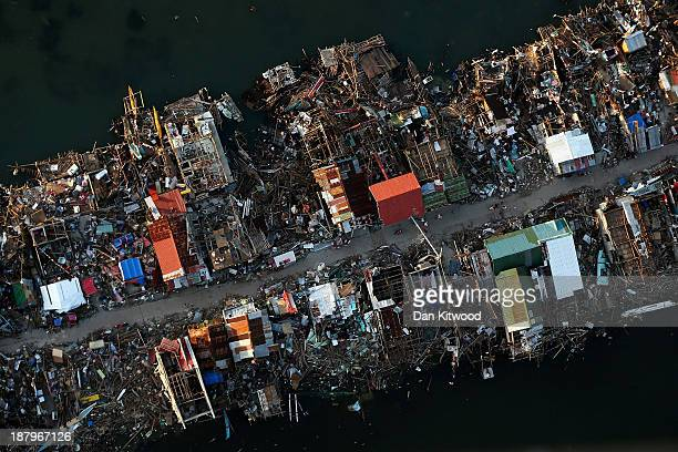 An aerial view of a demolished town on Eastern Samar Island on November 14 2013 in Leyte Philippines Typhoon Haiyan which ripped through Philippines...