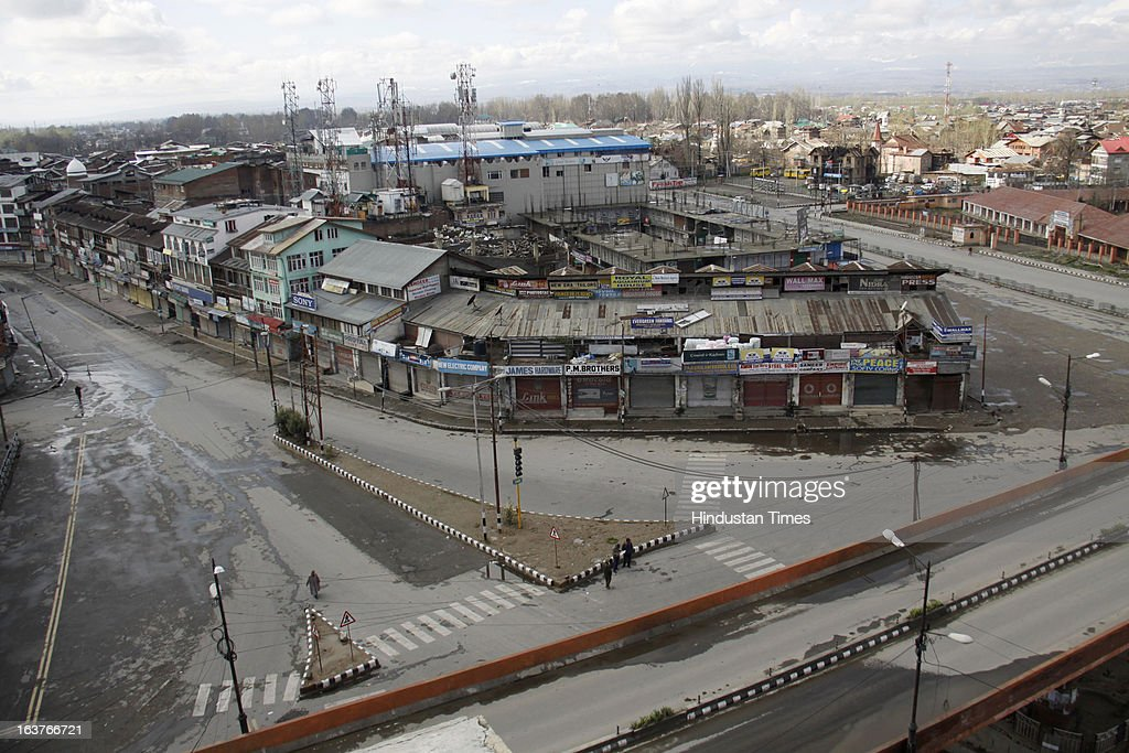 An aerial view of a deserted streets during a curfew, on March 15, 2013 on Srinagar, India. Curfew continued for the second consecutive day in Srinagar district following the alleged firing by CRPF personnel on Wednesday in which a youth was killed. CRPF personnel allegedly opened fire after coming under attack by a group of stone pelters while on their way to hospital to donate blood for their colleagues injured in terror attack.
