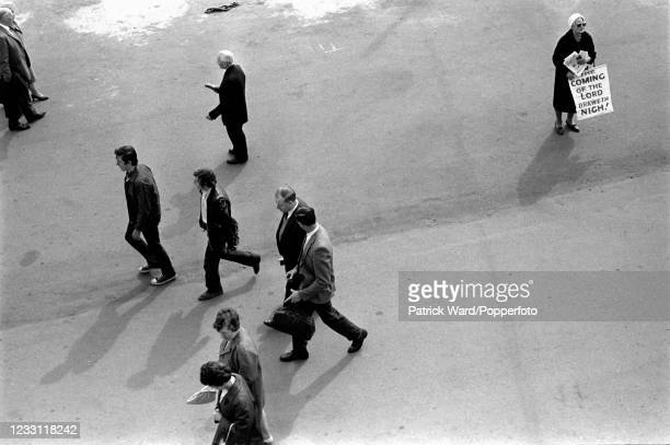 An aerial view of a doom-sayer and pedestrians on the promenade at Brighton, circa June 1969. From a series of images to illustrate the many...