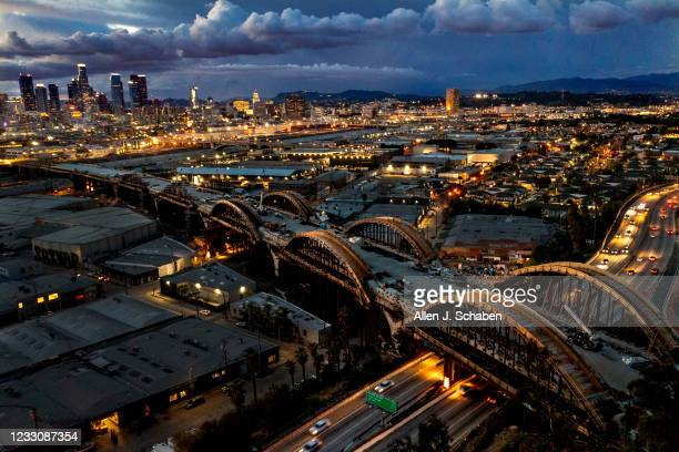 April 15: An aerial view of a dramatic sky over the Los Angeles skyline as progress is underway on the Sixth Street Viaduct Replacement Project that...