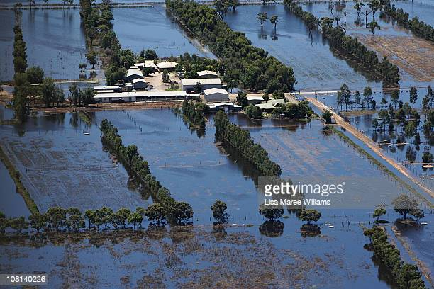 An aerial view of a farm house inundated by flood waters on January 19 2011 in Kerang Australia Evacuations have been ordered in several western and...