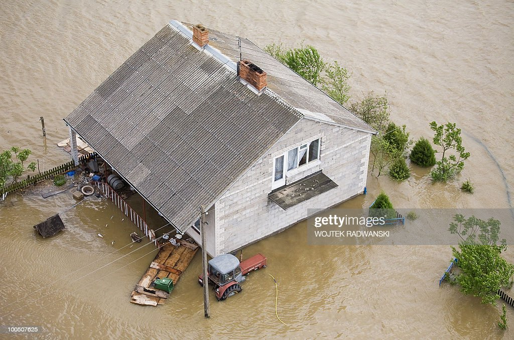 An aerial view of a flooded house of Swiniary village in central Poland at Wisla river is seen on May 25, 2010. Floods caused by torrential rains last week have swollen major Polish rivers to their highest levels in more than a century and have claimed 15 lives.