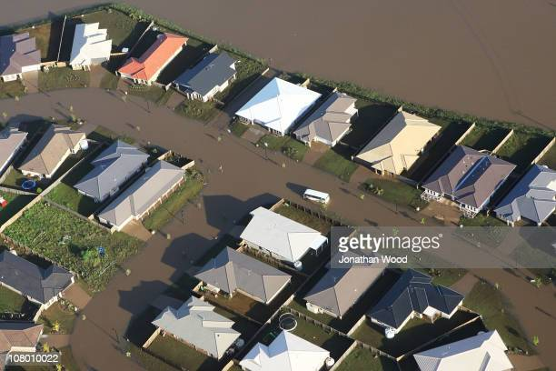 An aerial view of a flooded suburban area west of Brisbane on January 13 2011 in Brisbane Australia Twelve people have been confirmed dead in towns...