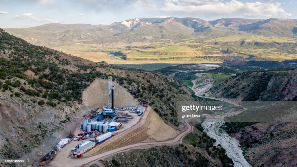An Aerial View Of A Fracking Drill Rig On The Side Of A Mountain In Colorado In Late Spring : Stock Photo