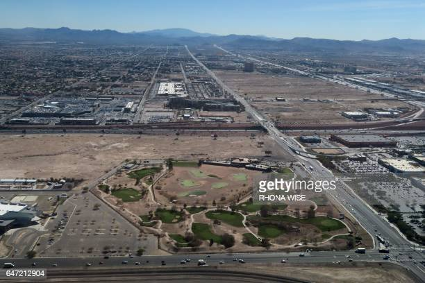 An aerial view of a golf course from a plane leaving McCarran International Airport in Las Vegas Nevada on February 15 2017 / AFP PHOTO / RHONA WISE