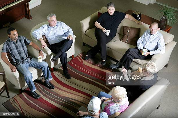 An aerial view of a group of people on couches