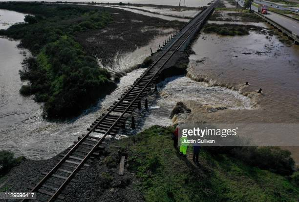An aerial view of a levee that was breached during a rain storm on February 14 2019 in Novato California The San Francisco Bay Area is cleaning up...
