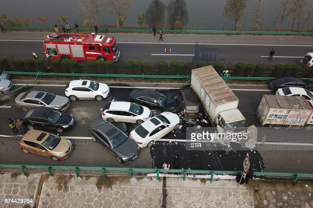 An aerial view of a major car accident on the highway near Yingshang Anhui province in eastern China on November 15 2017 A highway pileup involving...