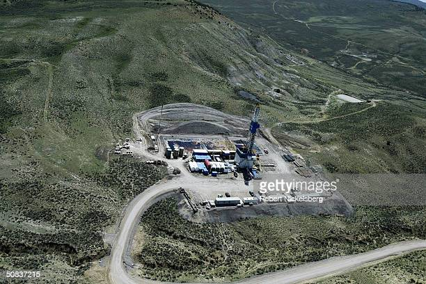 An aerial view of a natural gas drilling rig is seen May 7 2004 eight miles north of Evanston Wyoming The well is a wildcat operation in the...