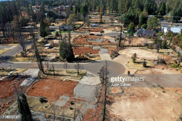 An aerial view of a neighborhood destroyed by the Camp Fire October 21 2019 in Paradise California It has been one year since the the Camp Fire...