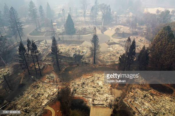 An aerial view of a neighborhood destroyed by the Camp Fire on November 15, 2018 in Paradise, California. Fueled by high winds and low humidity the...