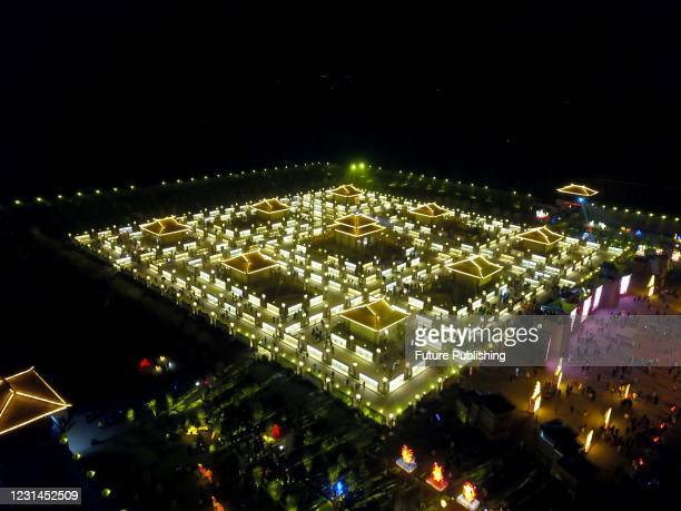 An aerial view of a one-way maze made of lanterns and billboards surrounding nine pavilions to celebrate the Lantern Festival in Zhangye city in...