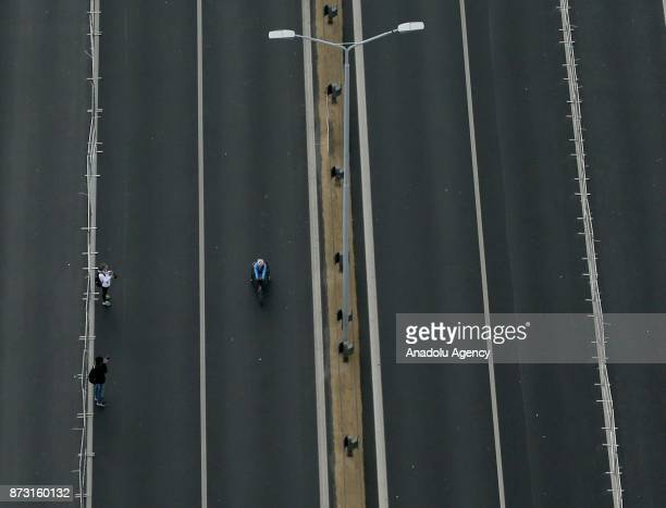An aerial view of a participant with a bike competing during Vodafone 39th Istanbul Marathon at The 15 July Martyrs Bridge in Istanbul Turkey on...