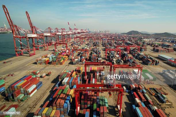 An aerial view of a port in Qingdao, east China's Shandong province on November 8, 2018. - China's exports to the US and the rest of the world grew...