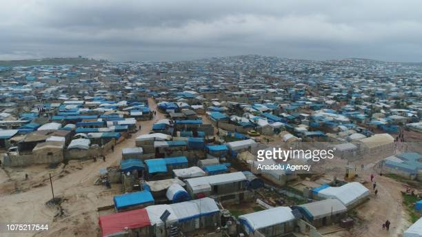 An aerial view of a refugee camp flooded after heavy rain on December 27 2018 in Idlib Syria Tens of thousands of Syrian refugees residing in camps...