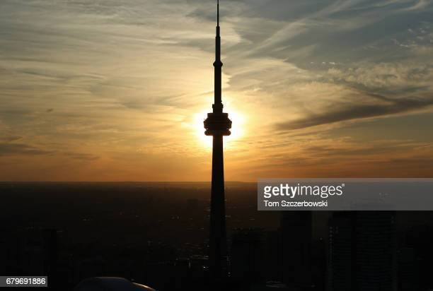 An aerial view of a silhouette of the CN Tower during a sunset on Toronto on May 3 2017 in Toronto Ontario Canada