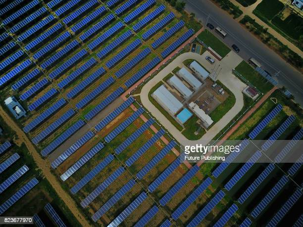 An aerial view of a solar farm in Jiangsu province on July 27 2017 in Funing China Various kinds of crop like rice green soybean and oily peony have...