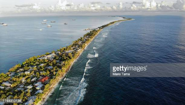 An aerial view of a strip of land between the Pacific Ocean and lagoon on November 28 2019 in Funafuti Tuvalu The lowlying South Pacific island...
