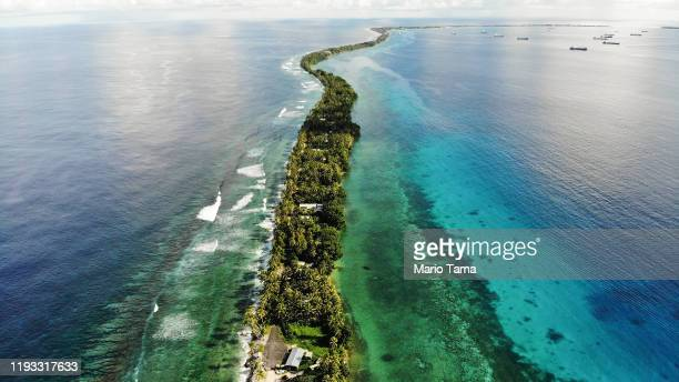 An aerial view of a strip of land between the Pacific Ocean and lagoon on November 25 2019 in Funafuti Tuvalu ThelowlyingSouth Pacific island...
