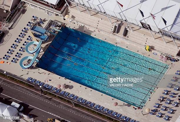 An aerial view of a swimming pool on the side of a harbor on September 20 in Monaco AFP PHOTO / VALERY HACHE