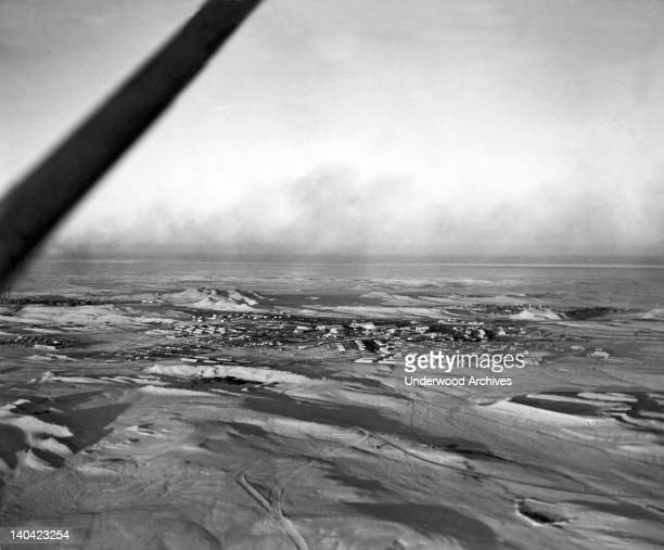An aerial view of a town erected by the ArabianAmerican Oil Company to house some 1500 American oil workers and their families Dhahran Saudi Arabia...