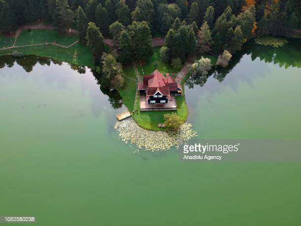 An aerial view of a wooden Lake house inside forest at Golcuk Nature Park during autumn season in Bolu province of Turkey on October 19 2018 Forests...